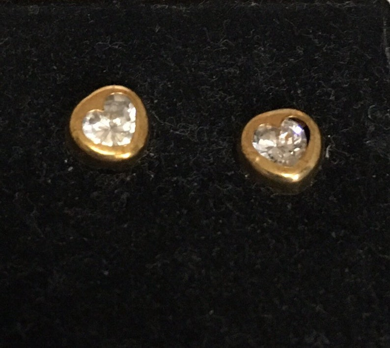 Cubic zirconia heart stud earrings with brass outline image 0