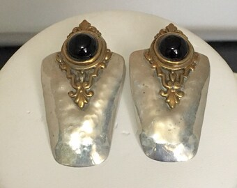 Sterling silver stud earrings with brass accents and black onyx stone