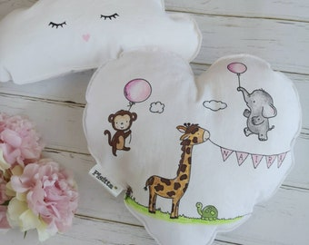 Heart-shaped pillow for 'welcome small' babies