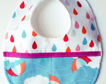 "Bib with ""Rainbow Rain"" pockets"