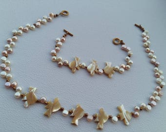 vintage  pearly look necklace and bracelet set with carved birds.
