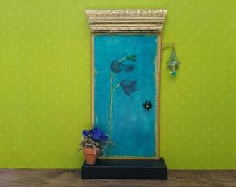 Indoor Turquoise Fairy Door with Flower Motif and Porch Light