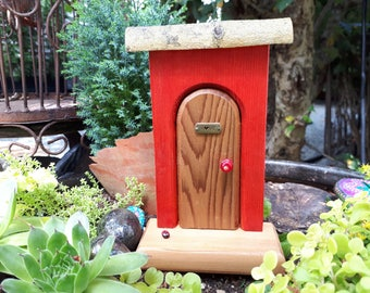 Brown Arched Fairy Door on Red Wall, with 'LOVE' sign and Lady Bug