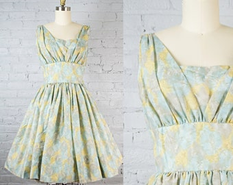 381f9ec1e8c vintage 50s style party dress . 1950s floral print blue cocktail dress .  sleeveless fit and flare dress . small