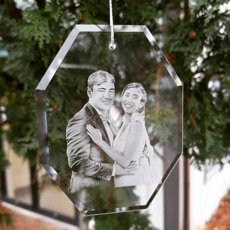This glass ornament with the photo sophisticatedly etched by lasers into a glass octagon looks quite simple, but it is a fitting crystal anniversary gift for your spouse. This item is highly recommended to be very permanent and fade resistant.