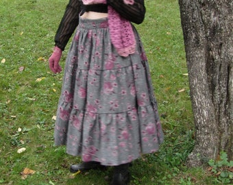 Long skirt with ruffle and pink flowers
