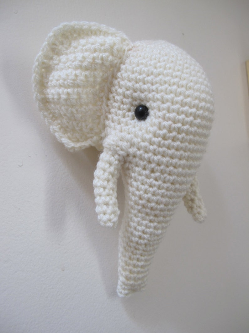 Crochet elephant head, trophy style stuffed wall hanging off white color