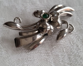 Sterling Silver Bond Boyd pin with green stone