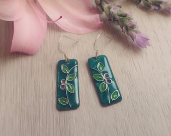 Blue glazed earrings with leaf branches