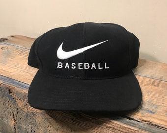 7af8fda2788 Vintage nike baseball hat    embroidered big swoosh logo    black and white  cap    90s Nike snapback    retro throwback rare hat