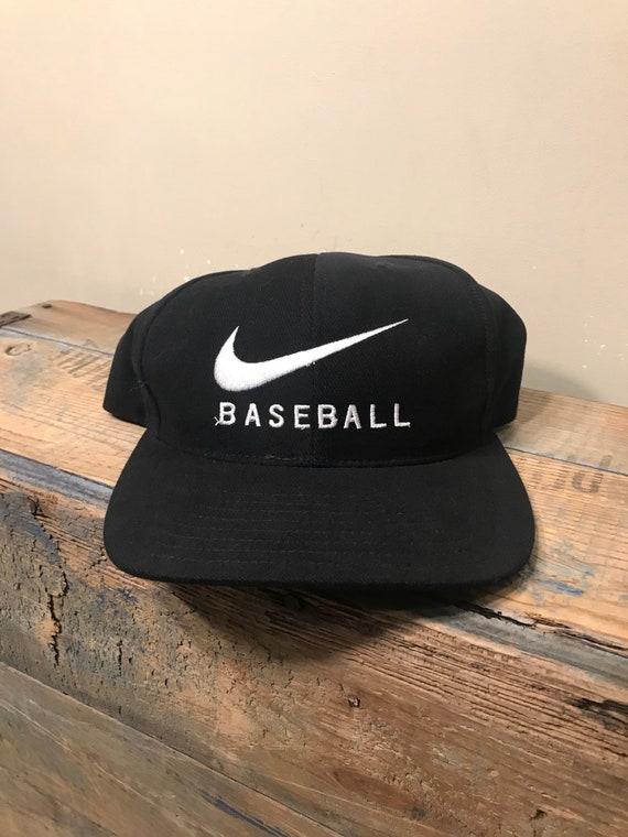 Vintage nike baseball hat    embroidered big swoosh logo     84497f253be