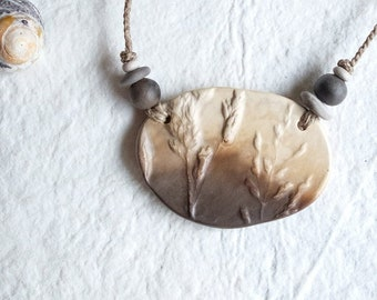 Necklace - Imprint of plant on a smoked fired ceramic piece - flax rope - handmade