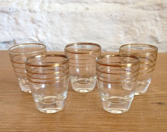 Vintage 1950's Set of 5 Gold Gilt Striped Shot Glass. Lovely glasses in very Good Condition.