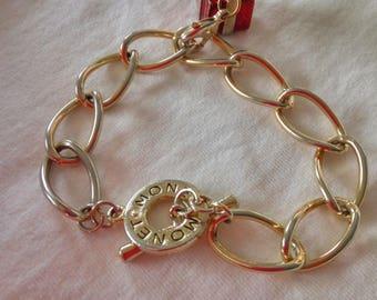 69111528b1d8 Gold tone Vintage Monet Charm Bracelet with a Red Enamel Gift Box Charm.