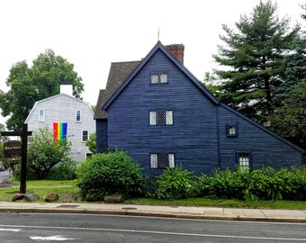 Pride Flag hanging next to the Witch House in Salem