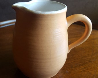 Franciscan earthenware, pottery, Sierre sand, white on the inside, creamer with applied handle,circa 1963-1971