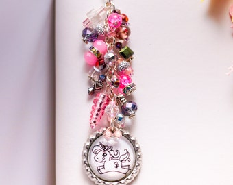 Pink and purple Beaded unicorn planner charm with foil lined lampwork glass unicorn horn and crystals. Blue and Cranberry Red also available