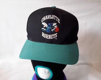 c46efdd4155b3 Vtg 90s Charlotte Hornets NBA snapback hat cap