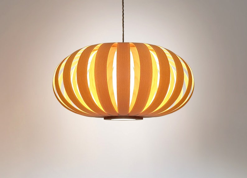 Modern and natural ceiling light from ash and baltic birch. Pendant lamp from wood