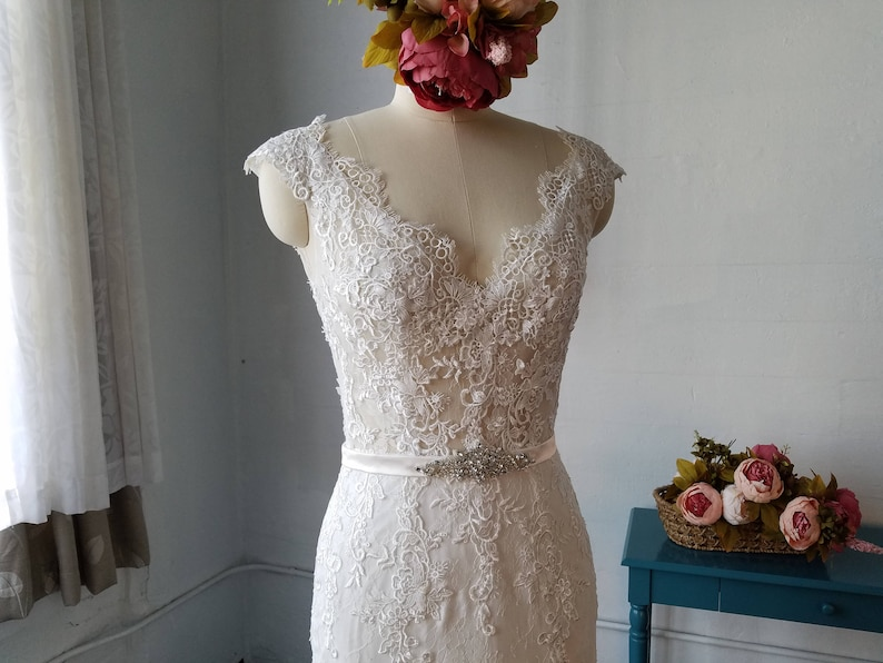 Cap Sleeves Mermaid Lace Wedding DressV Neck Beaded Lace image 0