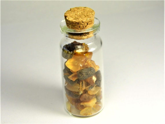 Small souvenir glass bottle with natural genuine Baltic Amber stones inside 3716