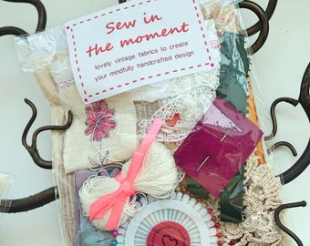 slow sewing kit for mindfulness from upcycled and vintage fabric, ribbons and findings. Whole craft kit in a bag with instructional leaflet