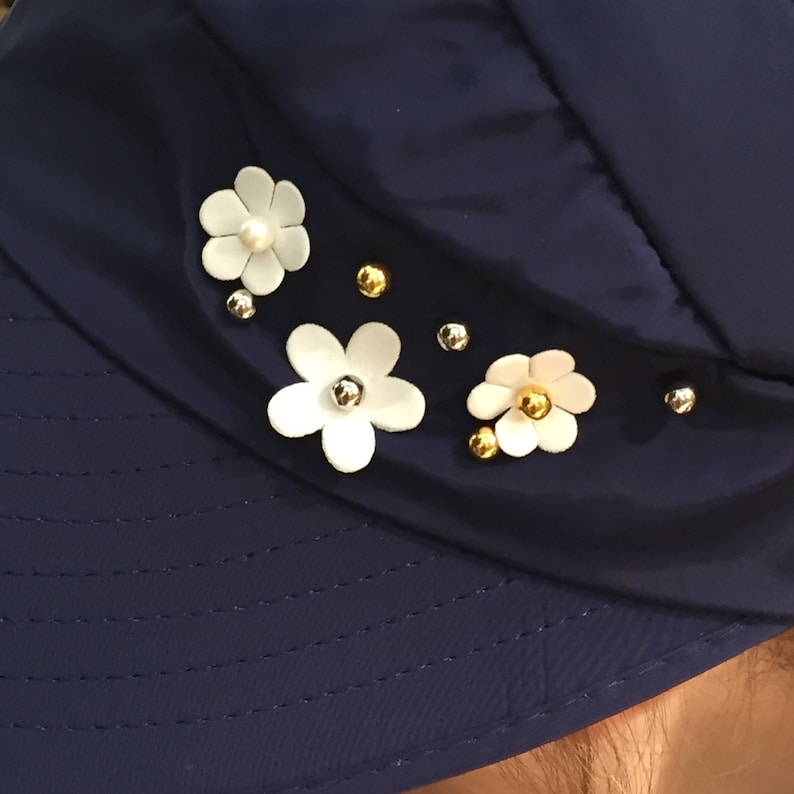 Blue Visor Foldable Hat with Pretty White Flowers Rhinestones and Studs Monogrammed with Messy Bun /& Too Much Sun