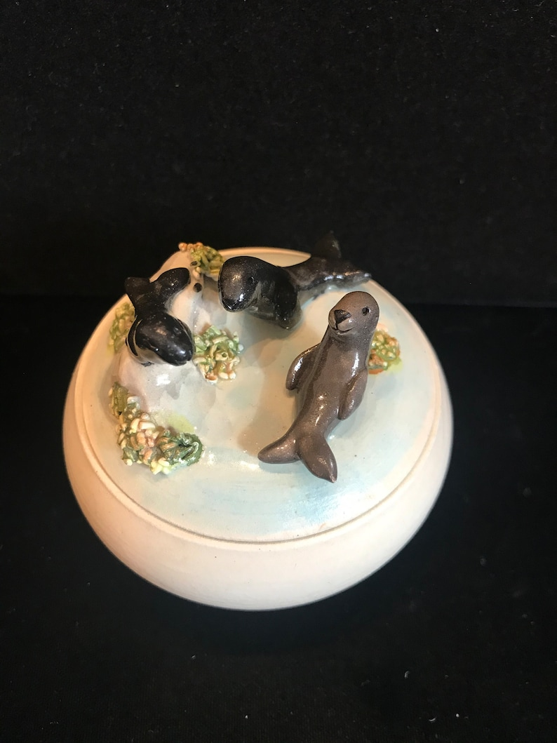 adorable 3-D seals on top. Pottery trinket jar with lid