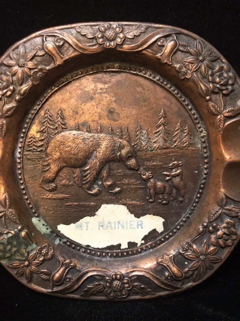 Vintage souvenir Copper ashtray of mount rainier with hair in bear cubs on the front.