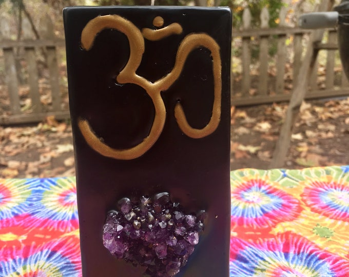 Crystal Candle~ Tall Square Pillar Candle with an Om Symbol in Gold and an inlaid Amethyst Crystal Cluster that illuminates when lit!