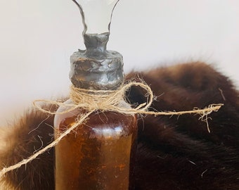 Vintage glass bottle with soldered Amber colored crystal