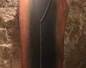 Gunmetal y necklace with a soldered pearl