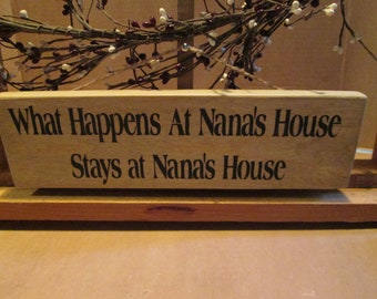What Happens At Nana's House ... wooden sign