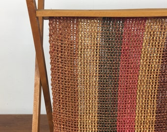 Large 1970s boho magazine rack with striped jute panels and wooden frame
