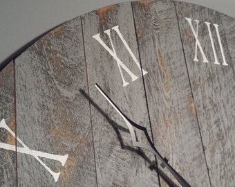 """Large Wall Clock, 36"""" Rustic grey with roman numerals, made from rough cut and distressed to give it that reclaimed, barn wood look."""