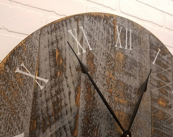"""24"""" Large rustic wall clock, made from rough cut lumber and finished to give it that reclaimed lumber / barn wood look."""