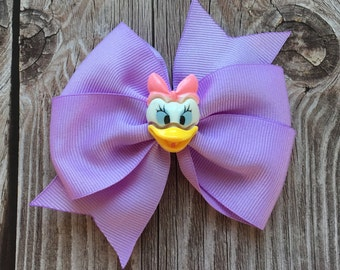 Daisy Duck Inspired Pinwheel Hair Bow On An Alligator Clip With Purple Ribbon