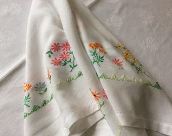 Hand-embroidered Tablecloth and Pair of Placemats.