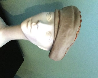 44859fdbca1 Yves Saint Laurent Leather Beret   YSL Paris New York Leather Beret Hat    Taupe Leather Orange Hand Stitching Measures 24