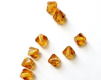 15 4 mm Topaz Swarovski Crystal bicone beads