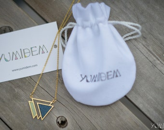 adorned with leather and blue triangle gold plated geometric necklace