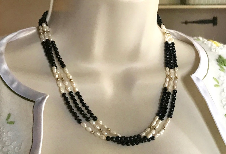c0aa507fe70ef Vintage Tripple Strand Rice Pearl Onyx and 14kt Gold Necklace
