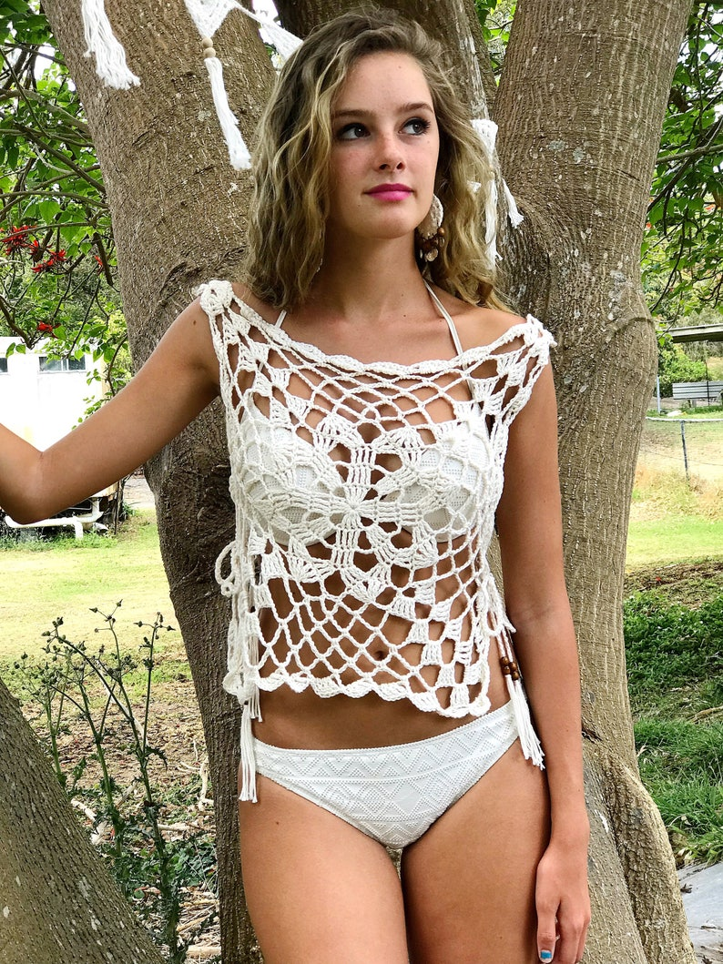 a84a63704af009 Crochet tunic with side slit. Crochet tank with side ties.