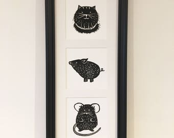 Piggy In The Middle series of mini lino prints