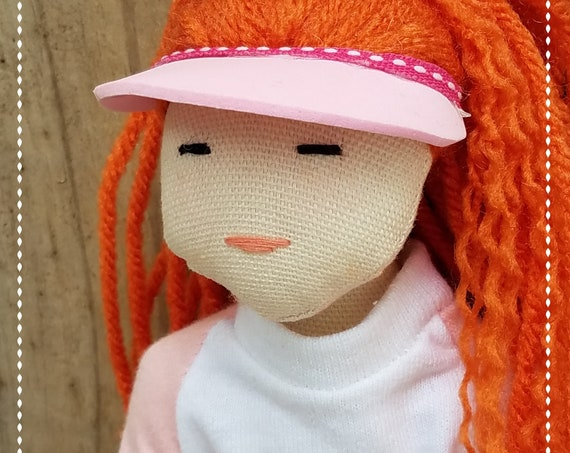 Red Hair doll in baseball shirt and pink visor