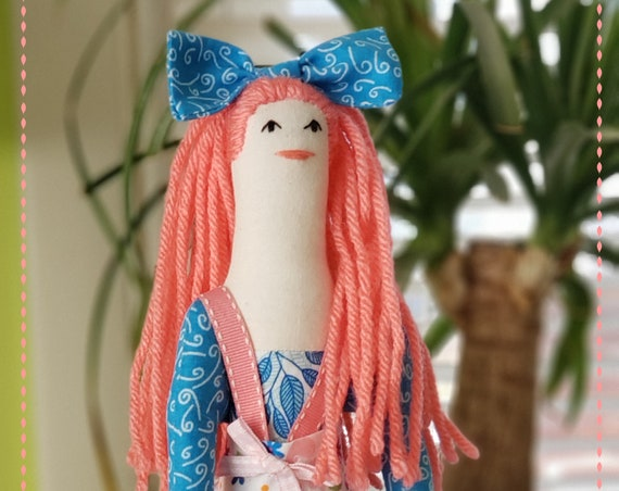 Rag doll coral pink hair and blue leggings