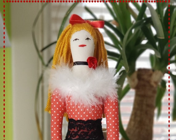 Pretty rag doll with ginger hair and black leggings