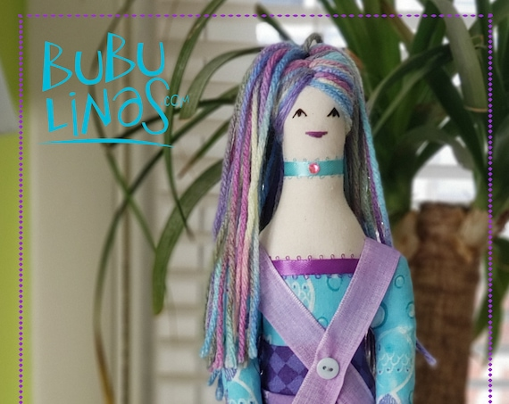 Lovely textile doll with colorful hair and purple dress