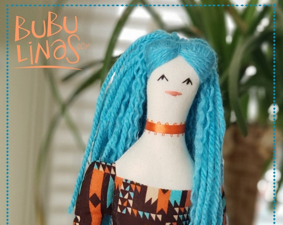 charming fabric doll with blue hair and pretty orange skirt