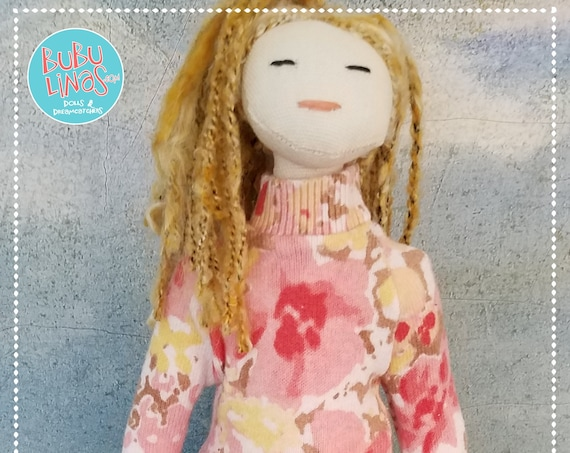 Cute handmade doll with blonde braids